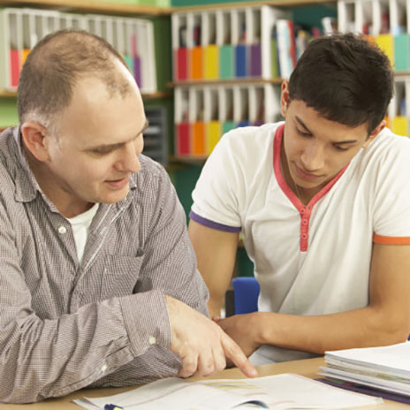 Photo of an instructor tutoring a student