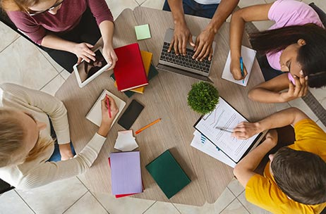 Overhead view of students sitting at a table
